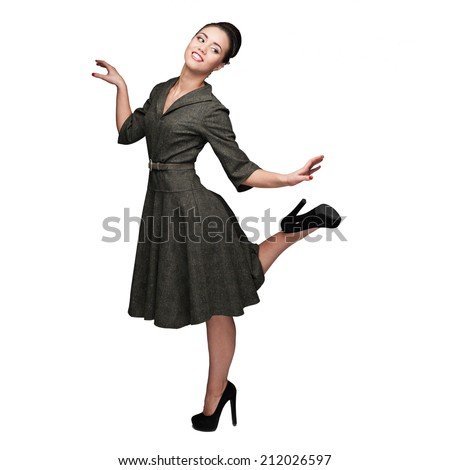 cheerful young caucasian woman in green vintage dress dancing isolated on white - stock photo