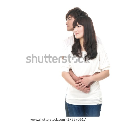 Cheerful young couple standing on white background, - stock photo