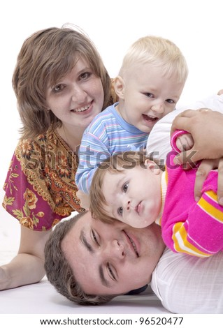 Cheerful young family - stock photo