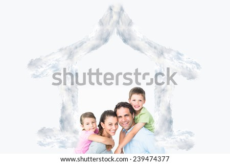 Cheerful young family looking at camera together against house outline in clouds - stock photo