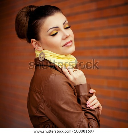 Cheerful young fashion woman with make up in autumn color - stock photo