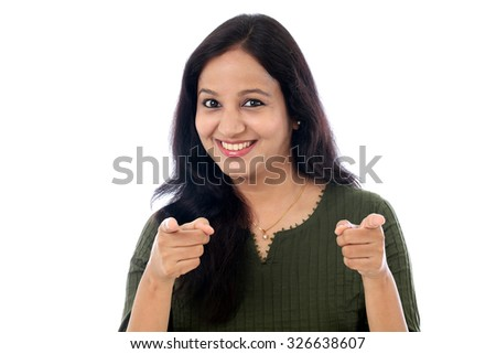 Cheerful young female against white background - stock photo