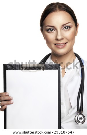 Cheerful young female doctor showing clipboard with copyspace for text or design and smiling, isolated over white background  - stock photo