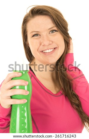 Cheerful young female model holding a green water bottle smiling - stock photo