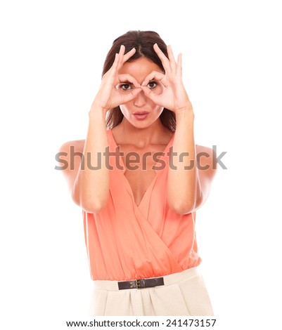 Cheerful young female with finger up gesturing glasses while looking at you in white background - stock photo
