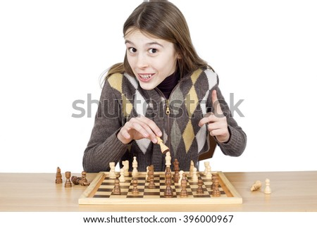Cheerful Young Girl With A Forefinger Up Looking At Camera Making A Good Move In Chess, Got Idea Gesture, Positive Emotion, Isolated On White Background - stock photo