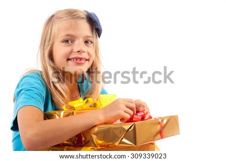 Cheerful young girl with gift boxes isolated on white - stock photo
