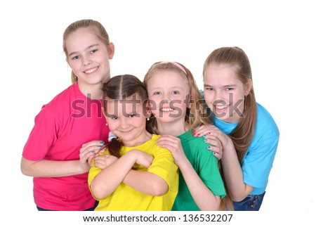 cheerful young girls in colored T-shirts on white background - stock photo