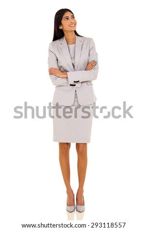 cheerful young indian businesswoman looking up - stock photo