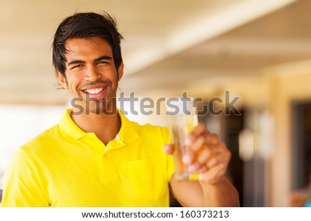 cheerful young indian man purpose a toast - stock photo