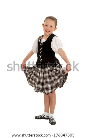 Cheerful Young Irish National Dancer in Ghillies and Performance Tartan - stock photo
