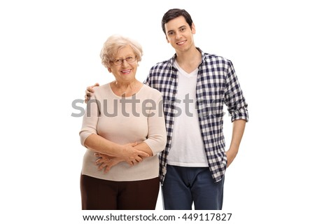 Cheerful young man posing together with his grandmother isolated on white background - stock photo