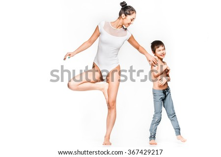 Cheerful young mom and happy son posing together while doing exercises - stock photo