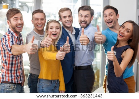 Cheerful young office workers are gesturing positively - stock photo