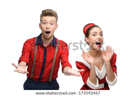 cheerful young surprised caucasian couple in red vintage clothing isolated on white - stock photo