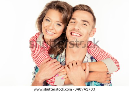 Cheerful young woman embracing her boyfriend - stock photo