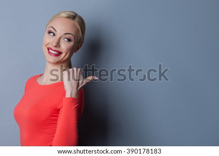 Cheerful young woman is gossiping with mockery - stock photo