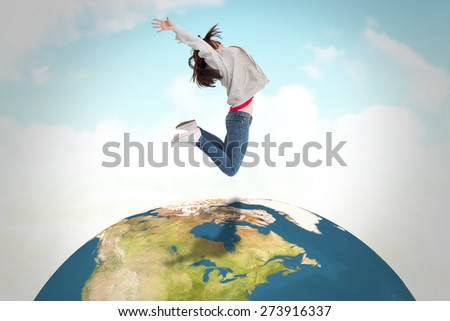 Cheerful young woman jumping against blue sky - stock photo
