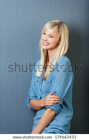 Cheerful young woman posing while looking at something - stock photo