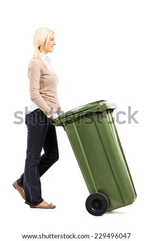 Cheerful young woman pushing a garbage can isolated on white background - stock photo