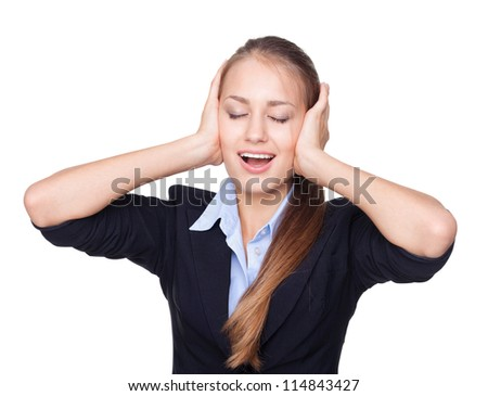 Cheerful young woman with eyes closed covering ears isolated white background - stock photo