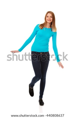 Cheerful young woman with toothy smile - stock photo