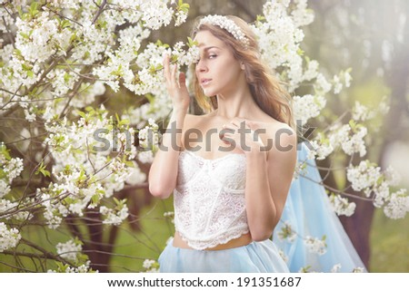 Cheerful young women with flowers  - stock photo