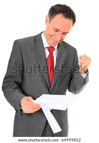 Cheering businessman reading letter. All on white background. - stock photo