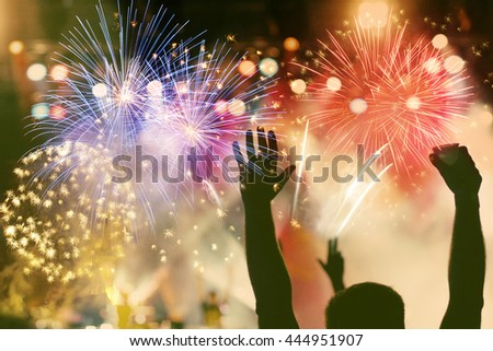 cheering crowd and fireworks - stock photo