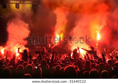 Cheering crowd at concert  , musicians on the stage - stock photo