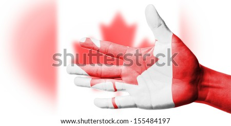 Cheering fan with Painting national Canada flag with your hand with your hand for cheer your national sport - stock photo