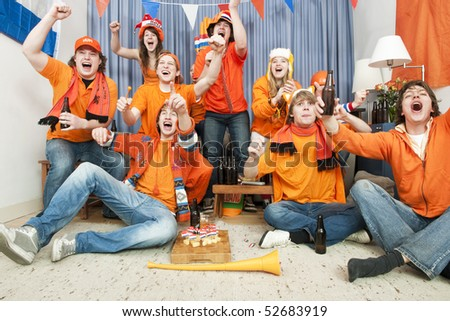 Cheering fans at home when their national team scores - stock photo
