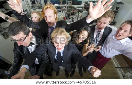 Cheering fans seen from above in a restaurant - stock photo