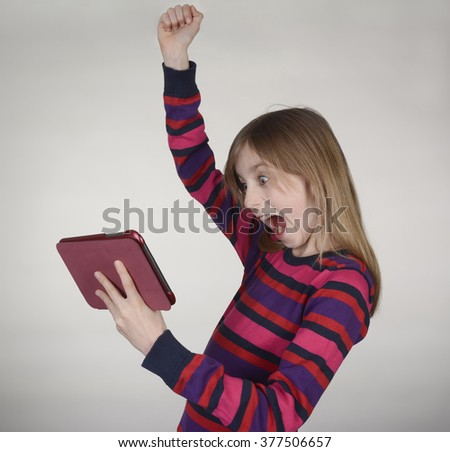cheering girl with digital tablet - stock photo