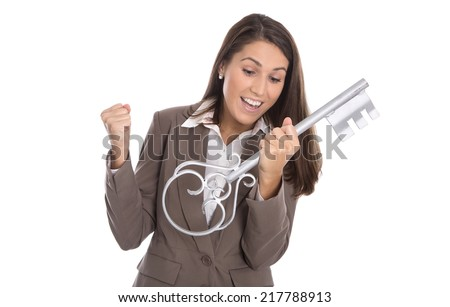 Cheering isolated woman holding key for her home in hands. - stock photo