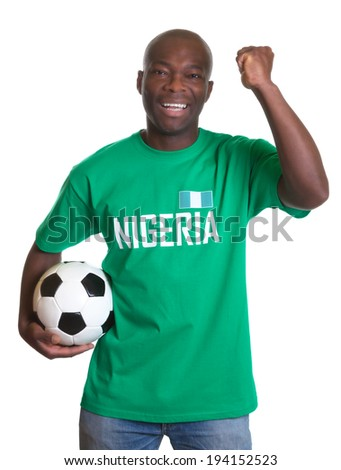 Cheering soccer fan from Nigeria with ball - stock photo
