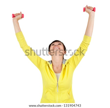 cheering young woman working out in the gym with small dumbbells, white background - stock photo