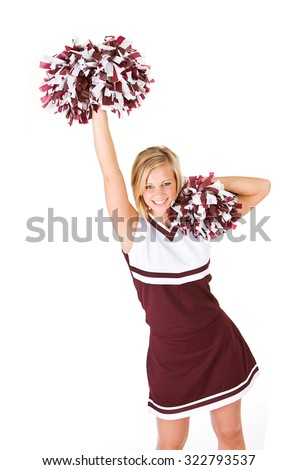 Cheerleader: Cute Woman Cheering With Poms In The Air - stock photo