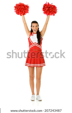 Cheerleader: Woman Cheering With Poms In The Air - stock photo