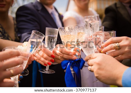 Cheers! friends celebrating a wedding  party and clinckind glasses - stock photo