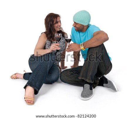 Cheers! Man and woman drinking wine, sitting close to each other. - stock photo