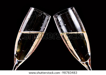 cheers - two champagne glasses - stock photo