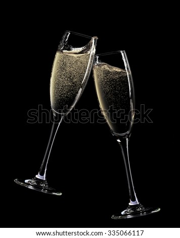 Cheers! Two champagne glasses. Isolated on black background - stock photo