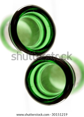 Cheers with beer bottles from bird's-eye view - stock photo