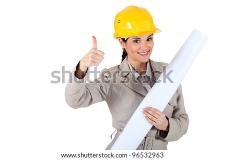 Cheery female architect giving the go-ahead - stock photo