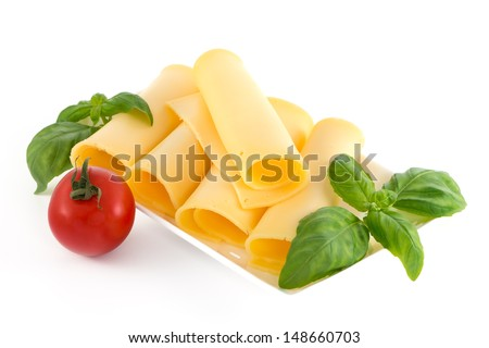 Cheese and basil leaves still life isolated on white background - stock photo