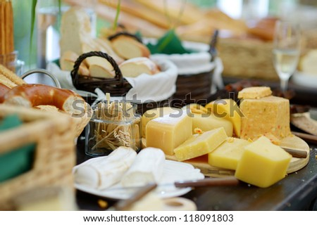 Cheese and bread assortment on a table - stock photo