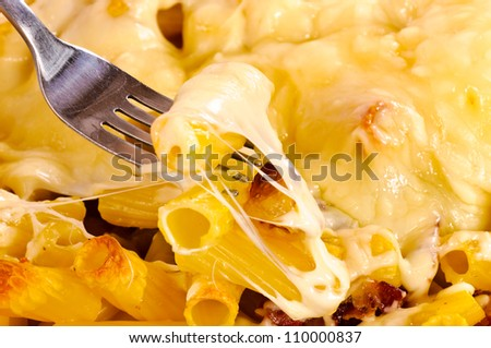 Cheese and macaroni with bacon - stock photo