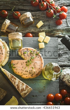 Cheese and Salami. Variety od cold cuts. Cheese on wood. Types of cheese and sausages - stock photo