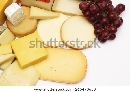 Cheese assortment and grapes - stock photo